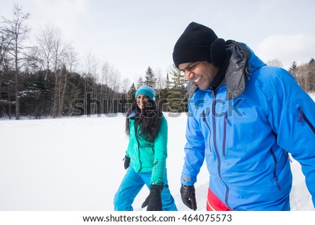 Indian couple snowshoeing