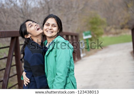 Indian loving mother and daughter in outdoors
