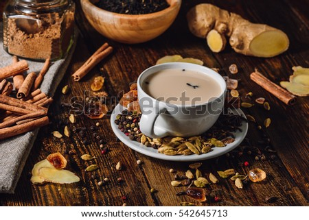 Indian Masala Tea in Cup with Ingrediants. Spicy Beverage.