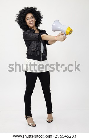 Indian teenage holding a megaphone on the white background