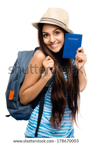 Indian woman tourist traveler holding passport excited for travel