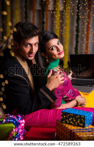 Indian young couple sitting close on diwali