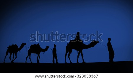 Indigenous Indian Men Walking Through Desert Camel Concept