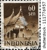 INDONESIA-CIRCA 1949: A stamp printed in Indonesia shows Minangkabau house, Sumatra, circa 1949 - stock photo