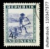 "INDONESIA-CIRCA 1948: A stamp printed in Indonesia shows Peasant, without inscription, from series ""Indonesian Vienna Issues"", circa 1948 - stock photo"