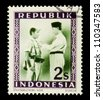 "INDONESIA-CIRCA 1948: A stamp printed in Indonesia shows Sukarno and soldier, without inscription, from series ""Indonesian Vienna Issues"", circa 1948 - stock photo"