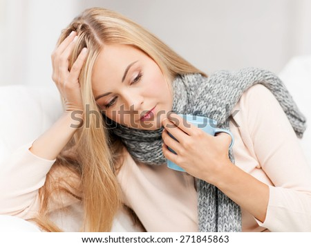 indoor picture of diseased woman with cup of tea