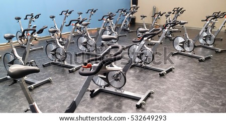 Indoor stationary bikes for spinning cycling classes. Nobody. Horizontal.