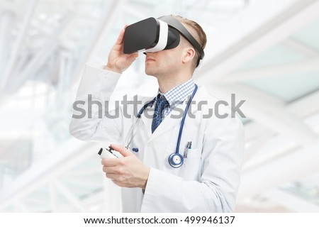 Indoors close up shot of doctor wearing virtual reality glasses