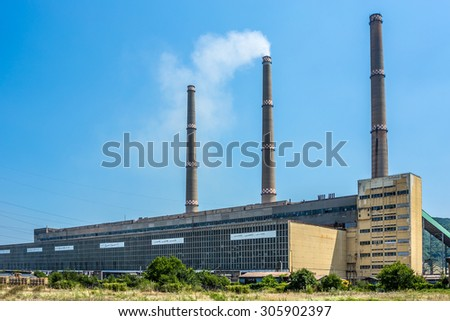 Industrial building with smoking chimneys