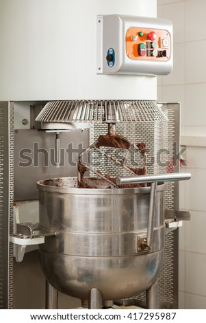 Industrial Mixer With Control Panel. Huge Mixer With Brown Dough. Fast Pace  Of Production