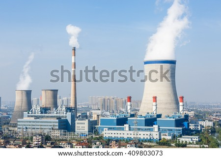 Industrial power plant smoke pollution in the blue sky