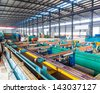 Industrial zone, steel pipelines and cables in a plant - stock photo
