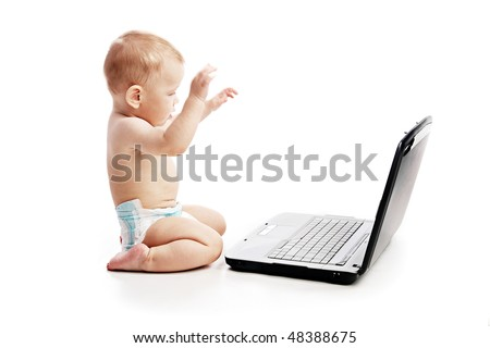 Infant using laptop over white