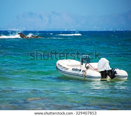 Inflatable motor boat on sea. Space for your text.