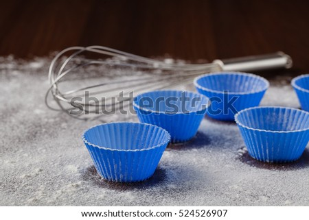 Ingredients for baking muffins on wooden table, close-up