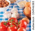 Ingredients for breakfast: tomatoes, eggs, garlic, peanuts, apples and lettuce. - stock photo