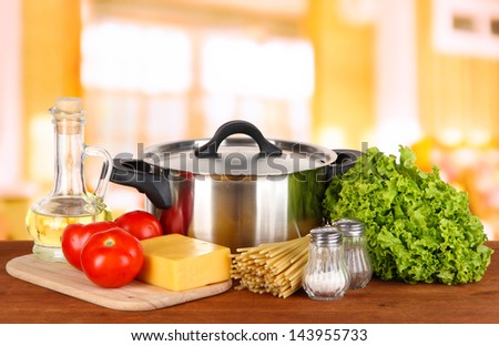 Ingredients for cooking pasta on table in kitchen