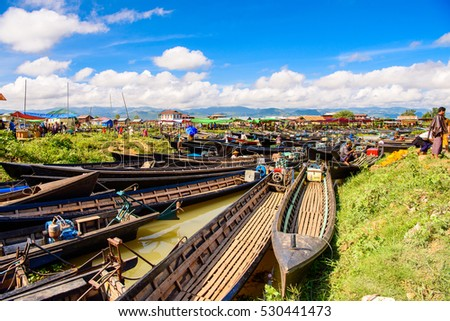 INLE LAKE, MYANMAR - AUG 30, 2016: Bamboo boats over the Inle Sap,a freshwater lake located in the Nyaungshwe Township of Taunggyi District of Shan State, Myanmar