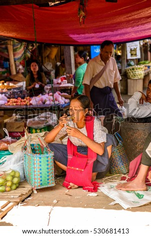 INLE LAKE, MYANMAR - AUG 30, 2016: Unidentified Burmese woman works at the market place, the Inle Sap,a freshwater lake  in the Nyaungshwe Township of Taunggyi District of Shan State, Myanmar