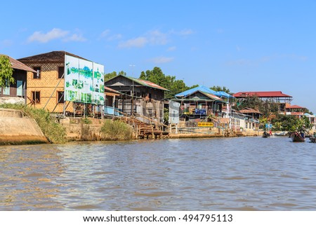 INLE LAKE, MYANMAR - DEC 8: Local house along the river on Dec 8, 2014 in Inle. The people of Inle live in four cities bordering the lake, in numerous small villages along the lake's shores.