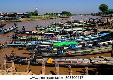 INLE LAKE, MYANMAR - FEB 26: Floating houses in a vilage on February 26, 2015 in Inle Lake, Myanmar. Inle lake is a famous lake for tourism in Myanmar.