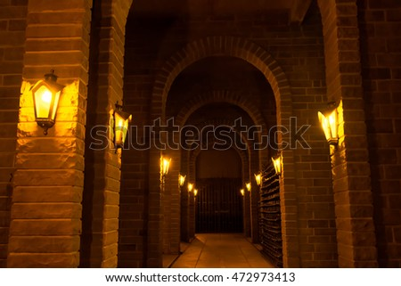 inside a winery with yellow lighting