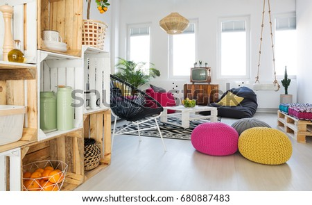 living room swing. Inspiring trendy living room with DIY crate shelf and swing Colorful Retro Living Room Pouf Tv Stock Photo 640290472