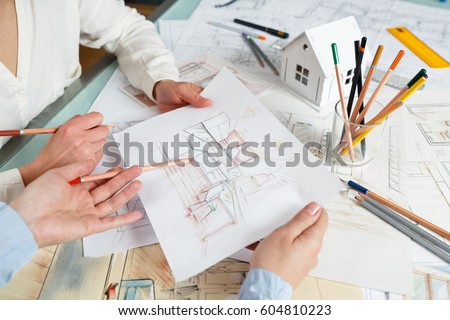Interior Designers At Work interior designer works on hand drawing stock photo 135392435