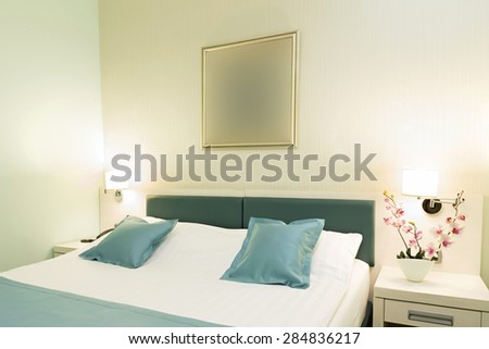 Interior of a hotel bedroom in the evening