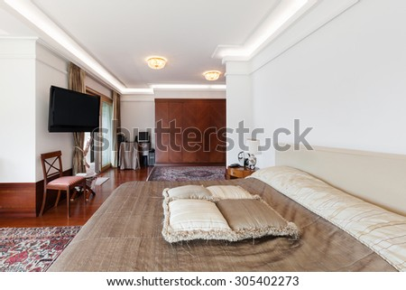 Interior of a modern apartment, classic decor, bedroom