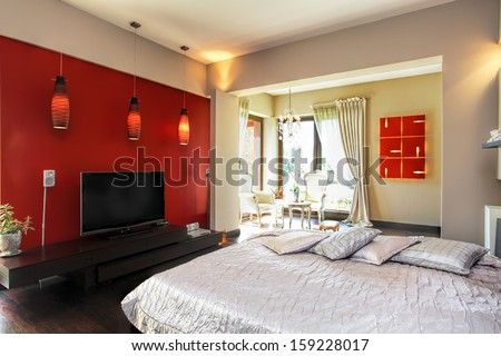 Interior of a modern red and white bedroom