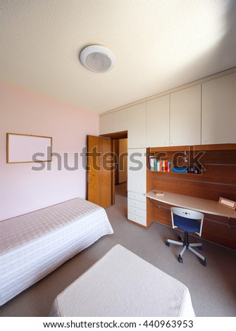 Interior of an old apartment, bedroom with single bed and desk