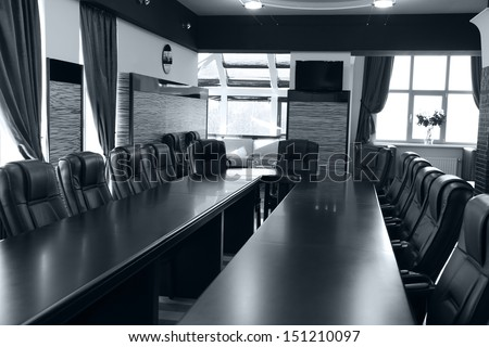Interior of empty conference room in shades of grey