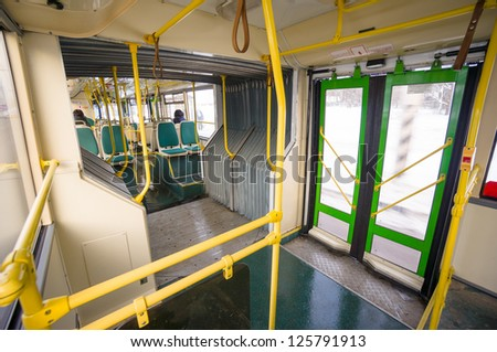 Interior of modern city articulated bus. Articulated joint and door in back side of bus