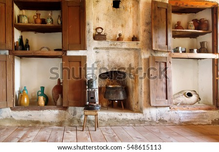 Interior of old house in Georgia country, with kitchen utensils, kettle, primus, fireplace and the wooden floor