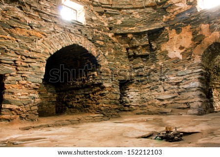 Interior of the all stone 15-th century caravanserai Tash Rabat, in Kyrgyzstan. Some argue that it was originally a Nestorian or Buddhist monastery going back to the tenth century.