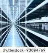 Interior of the new and modern warehouse space in a well lit large room - stock photo
