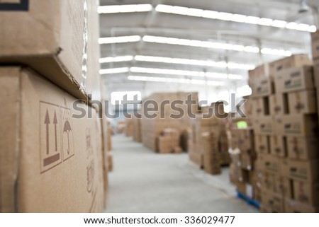 interior of warehouse. Rows of shelves with boxes