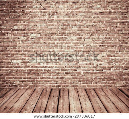 interior room with brick wall and wooden floor