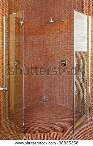 Interior shot of big shower in brown bathroom
