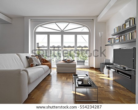 interior view of a modern living room with fabric sofa and bookcase overlooking on the terrace