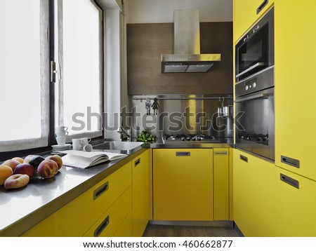 interior view of a yellow modern kitchen