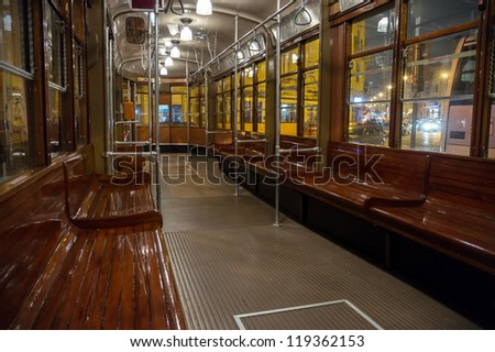 interior view of classic Milan tram by night, Italy