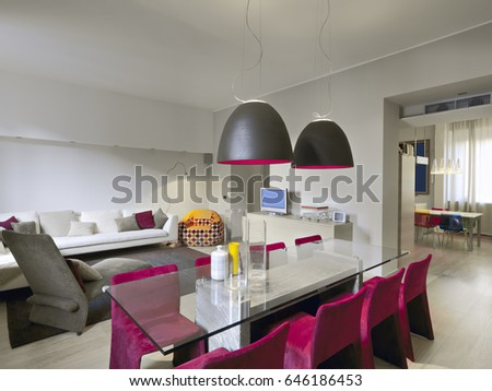 Interiors Shots Of A Modern Living Room In Foreground Glass Dining Table Overlooking On The