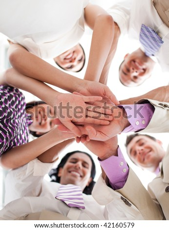 International business people holding hands together against white background