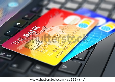 Internet banking, accounting and online shopping web security business commercial concept: 3D render of macro view of the group of color credit cards on laptop or notebook keyboard with focus effect