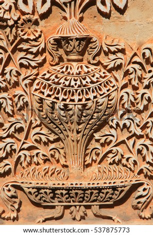 Intricate design carved on walls of Paigah tombs ruins in Hyderabad India