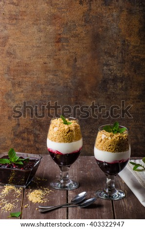 Inverted cheesecake dessert in glass, delicious and simple with fresh fruits and biscuit with light creame.