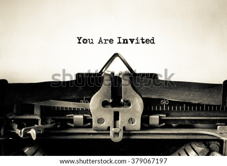 Invitation message typed on vintage typewriter